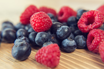 Blueberry and raspberry on a wooden table