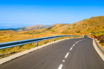 Road and beautiful mountain scenery near Pico do Arieiro, Madeira island, Portugal