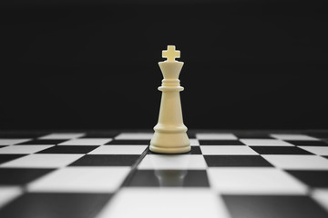 king of the winner on chess board game, competition and strategy concept