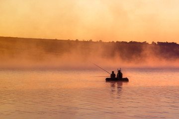 Fishermen in a boat at dawn