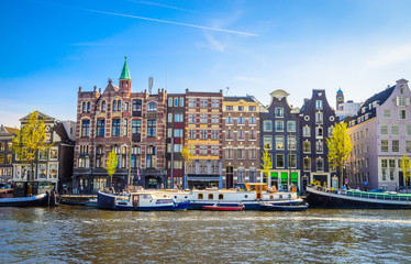 Keuken foto achterwand Zalm Traditional old buildings and and boats in Amsterdam, Netherlands. Canals of Amsterdam.
