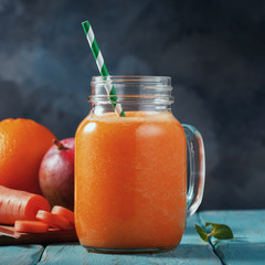 Smoothies of mango, orange and carrot with space for text