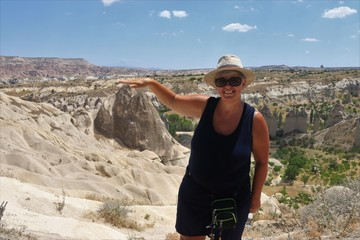 An English lady visiting the famous Fairy Chimneys in Cappadocia, Goreme, 2017