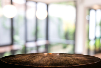 Image of Selected focus empty wooden table and Coffee shop or blurred cafe background of abstract with bokeh image. for montage or display your products