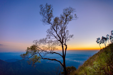 Beautiful sunrise view at Den Chang Non, Pha Peung, Pua, Nan, Thailand. Dramatic morning dawn mountain background.