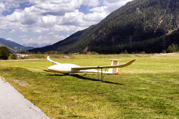 A covered glider in the mountain of Switzerland