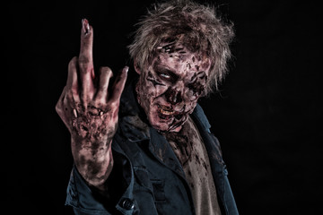 Bloody zombie man with brains out horror halloween