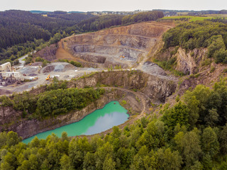 Aerial of an asphalt opencast mine in Reichshof - Germany