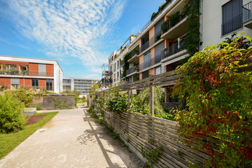 Modern residential buildings, new apartment houses with green outdoor facilities in the city