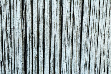 Dark texture of old natural wood with cracks from exposure to sun and wind