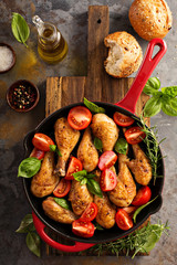 Roasted chicken drumsticks in a cast iron pan