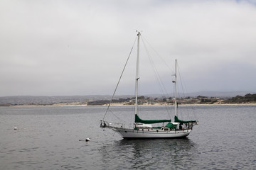 Two-Masted Wooden Sailboat Moored To Buoy Monterey California
