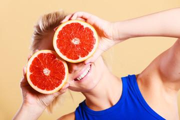 Woman holding grapefruit citrus fruit in hands