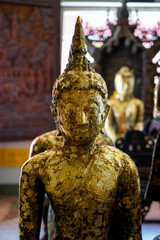 Beautiful old standing buddha image statue covered by gold leaf, Asokaram temple
