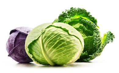 Three fresh organic cabbage heads isolated on white