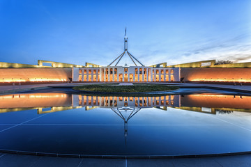 Dramatic evening sky over Parliament House, illuminated at twilight. Which was the world's most expensive building when it was completed in 1988 in Canberra, Australia Wall mural
