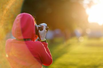 Photographer on blurry park background