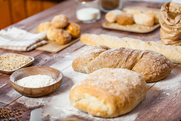 Freshly baked delicious bread on a rustic wooden table, healthy eating concept