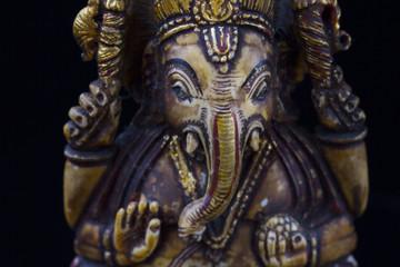 Close up golden Bronze Ganesha statue  and Golden texture ganesh is hindu god god of Success