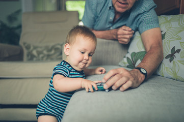 Grandfather playing with baby grandson