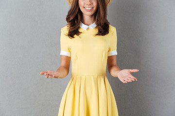 Cropped image of a smiling girl with outstretched hands