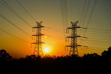 High voltage power tower at sunset in Brisbane, Queensland.
