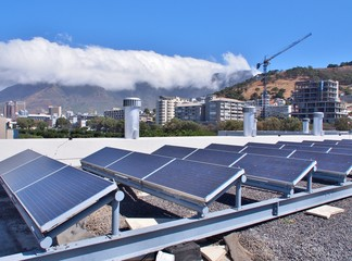 Solar panels or Solar cells on rooftop or terrace of building in Cape Town, South Africa. Can saving energy. Green or Sun or renewable or Clean energy.