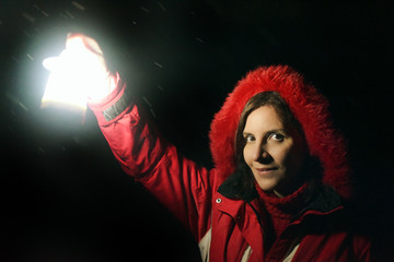 Woman in the dark with a flashlight