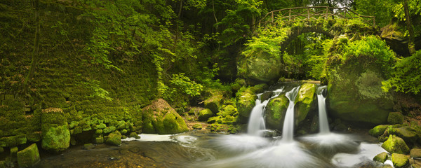 Stone bridge and waterfall in Luxembourg