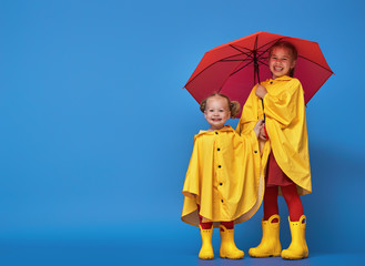 children with red umbrella