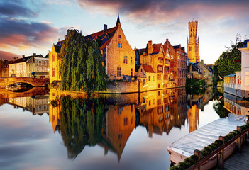 Belgium - Brugge, Rozenhoedkaai with Perez de Malvenda house and Belfort van Brugge at sunset