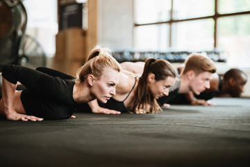 Sports strong people in gym make sports exercises