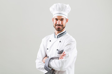 Portrait of  chef on gray background.
