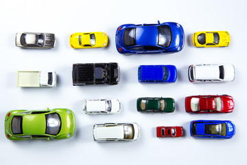 top view on colorful car toys on white background