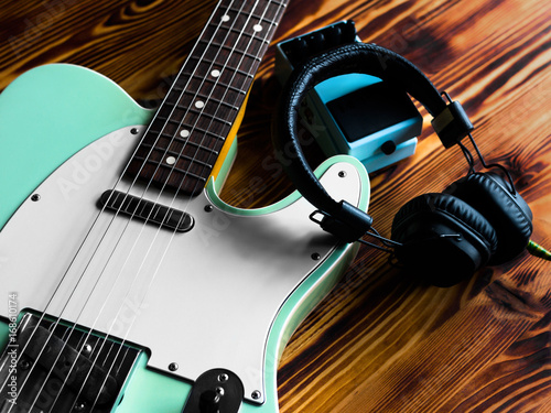 electric guitar pedal and headphones on vintage wooden table close up stock photo and. Black Bedroom Furniture Sets. Home Design Ideas
