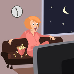amused woman sitting on the sofa with popcorn -