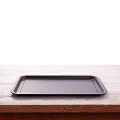 Empty baking tray for pizza on wooden table isolated close up top view square. Mock up for design
