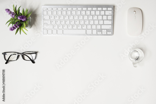 White Hipster Office Desk With Computer Gadgets And Supplies. Top View With  Copy Space,