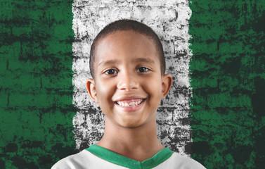 Black child against the flag of Nigeria