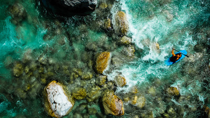 Emerald waters of Soca river, Slovenia, are the rafting paradise for adrenaline seekers and also nature lovers, aerial view. Wall mural