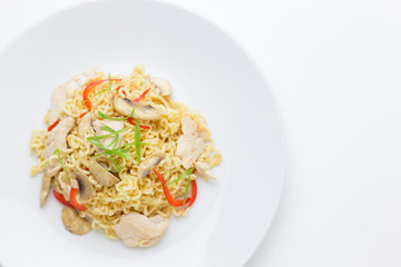 Stir-fry noodles with chicken meat, mushroom and red capsicum in a plate on white background copy space,top view