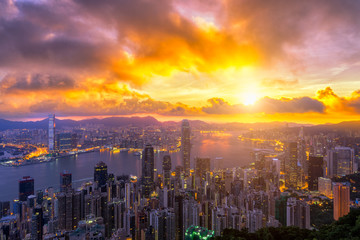 Wall Mural - Hong Kong City skyline at sunrise. from night to day
