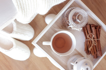 Cozy autumn. Home cosiness. Knitted plaid, hot tea, biscuits. Warm winter.