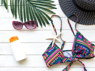 Summer Fashion woman bikini, big hat and accessories and sunglasses go to travel in the beach. Tropical sea.Unusual top view,  background.  Summer Concept.