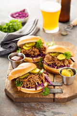 Pulled pork sandwiches with cabbage and pickles