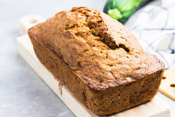 Zucchini loaf bread on concrete background.  Selective focus, space for text.