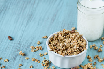 Almond Breakfast Cereal Granola With Glass of Milk Close Up