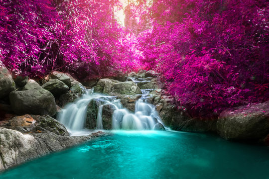 Beautiful colorful waterfall in autumn forest.