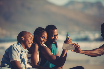 Friends at beach party taking selfie