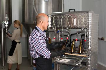 Man working on modern brewery.